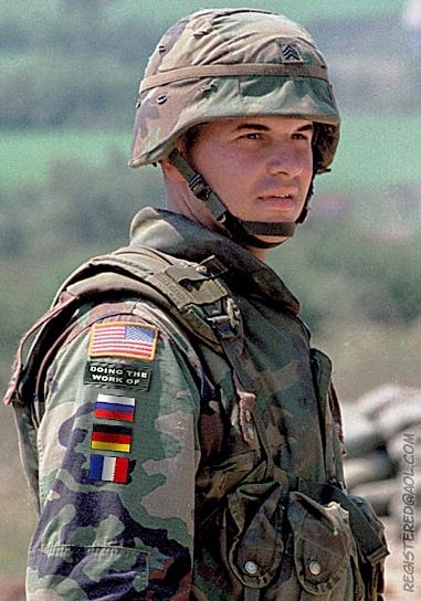 United states origin/reason for reversed flag on right shoulder.